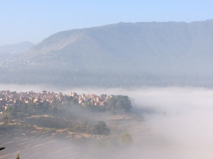 Early morning mists over nearby Khokana, one of the oldest Newari towns in the Kathmandu Valley