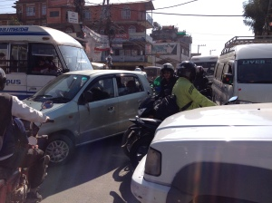 In traffic jammed Kathmandu, regular fuel shortages make hoarding fuel part of everyday life