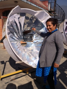 Pushpa used some of her CNN award money to buy solar inverters as well as this solar broiler where she is cooking beans. (copyright Donatella Lorch)