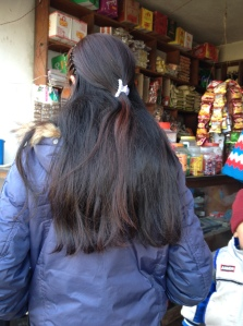 Young Nepali women frequently wear their hair cascading down their back.