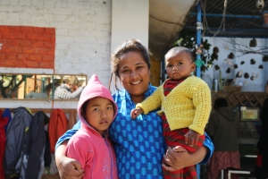 Pushpa Basnet with Sanu (left), the first child she met and rescued from prison life eight years ago . Fourteen month old Pushpanjali (right) is her youngest ward. (copyright Donatella Lorch)
