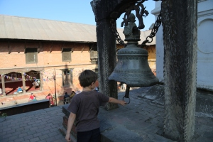 Waking Lord Shiva by ringing the bell in Mother Teresa's hospice (copyright Donatella Lorch)