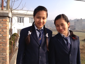 Two young girls on their way to school with the ubiquitous braids. copyright Donatella Lorch
