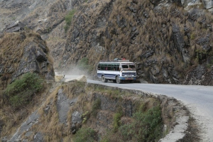 A bus drives through a recently cleared landslide on the road to Dadeldhura, Western Nepal © Donatella Lorch