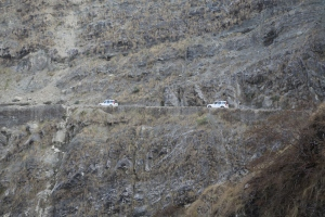 Paved roads in Nepal are few and far between. This is the only paved road into far Western Nepal. Here two UN vehicles navigate a narrow section © Donatella Lorch