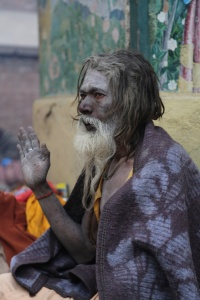 One Sadhu sat shivering covered only by a blanket. © Donatella Lorch