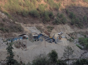 The cost of unfettered development is very visible in Nepal. Both licensed and illegal quarries strip the rivers of stone for building roads and houses but cause landslides, floods destroying homes and bridges. © Donatella Lorch