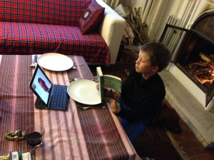 "Lucas reading ""Roman Mysteries"" to John on FaceTime just before dinner in Kathmandu. © Donatella Lorch"