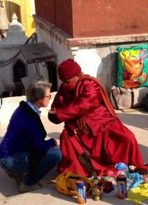 A Buddhist monk blesses me at Boudhanath Stupa in  Kathmandu. © Donatella Lorch