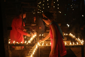 During Laxmi Puja, a festiva; that celebrates Laxmi, the Goddess of Wealth, Nepalese light up they city with butter lamps and worship her in the temples. ©Donatella Lorch