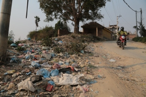 Open dumping is ubiquitous. Nepalis dump their garbage on roadsides, along river banks and when the pile grows they light the plastic bags covering neighborhood is carcinogenic dioxin. ©Donatella Lorch