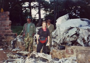 The genocide began within hours that the plane carrying the Rwandan president was shot down coming in for a landing in the capital Kigali. Once the Rwandan rebel army captured the Kigali airport, it was possible for journalists to visit the crash site. The president's country estate bordered the airport and part of the wreckage ended up near his swimming pool. The Rwandan Patriotic Front soliders hated having their pictures taken. The only way to do it was to pose with them. © Donatella Lorch
