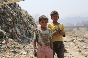 Young boys scavenge for copper wires in the mountain of refuse dredged from the Bagmati River. © Donatella Lorch