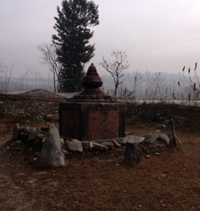 A solitary Shiva shrine sits amid wheat fields on the southern edge of the capital, Kathmandu. © Donatella Lorch