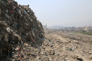 A mountain of garbage, mostly plastic bags dredged from the fetid (and holy) Bagmati River. © Donatella Lorch
