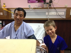 Lucas with Kaji Sherpa at  Kathmandu hospital. ©Donatella Lorch