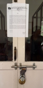 Padlocking, as a threat is often used by communist youth groups. Here a school accounting door was double locked and sealed. © Donatella Lorch