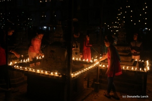 Nightime poetry during Tihar in Patan's old city. ©Donatella Lorch