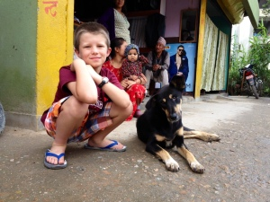 Lucas visit Raksi on her street side home where she lives with half a dozen other stray dogs. ©Donatella Lorch