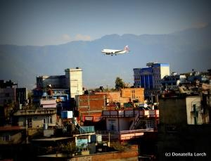 Planes landing at TIA skim Kathmandu rooftops. © Donatella Lorch