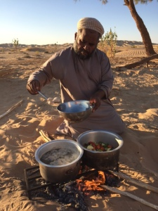 Bakhit cooking the evening meal. © Donatella Lorch