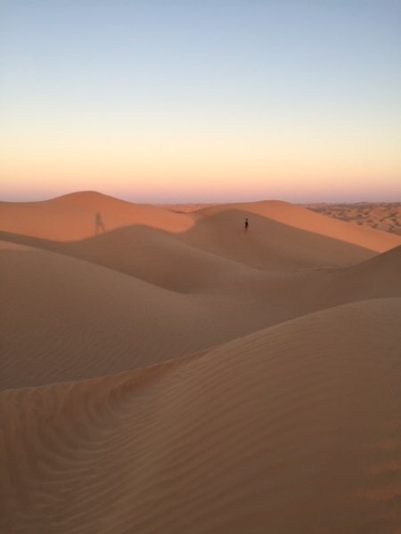 Hiking along the dunes at sunset after the desert begins to cool down. © Donatella Lorch